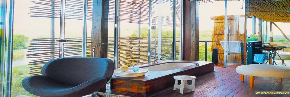 Bathroom with outdoor shower at Singita Lebombo Lodge