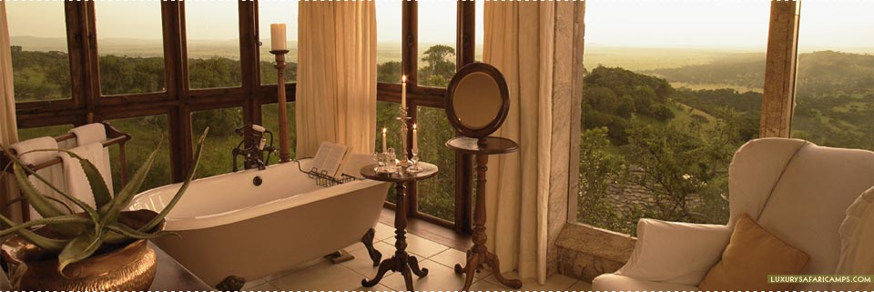 Bathroom with view at Singita Sasakwa Lodge
